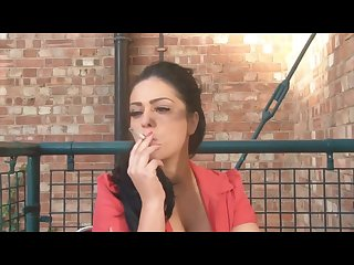 Cute woman smoking a cork