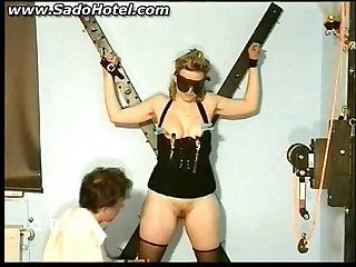 Slave tied to a wall gets clamps on her nipples and her pussy licked by her master BDSM