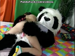 Attractive brunette girl seducing panda bear